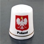 This porcelain thimble has the Polish eagle against a red background. Beautiful collector's item.