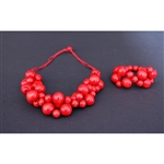 "This colorful folk necklace and bracelet are made of wooden beads painted and varnished.  The bracelet is a one size fits all on stretchy cord.  The necklace cord is not stretchy but is adjustable.  Necklace is 24"" - 61cm long (maximum)   Please note that"